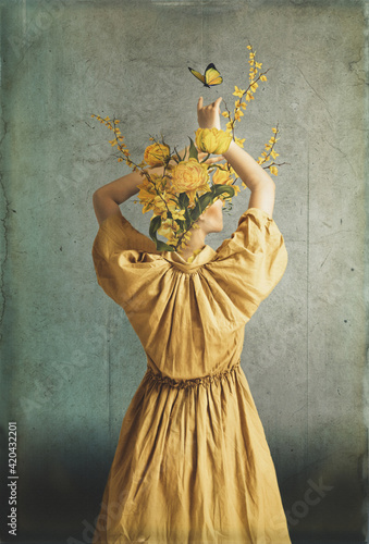 The body of a woman, her head is a yellow flowers Fototapeta