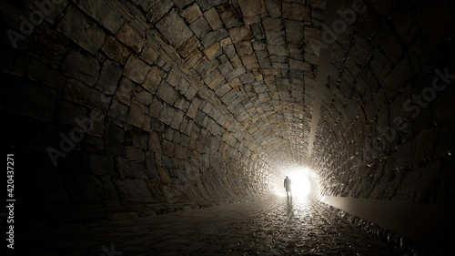 Fotografia Concept or conceptual dark tunnel with a bright light at the end or exit as meta