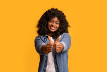 Happy Black Woman Showing Thumbs Up And Smiling