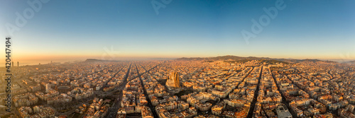 Aerial panorama drone shot of Barcelona city church in construction in sunrise hour in Spain winter