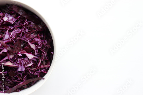 Valokuva Easy homecooked coleslaw from red cabbage in a bowl on white table background