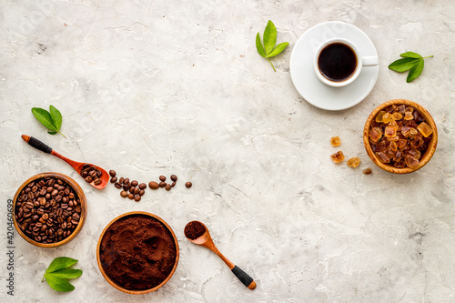 Foto Espresso in white cup and coffee beans, top view