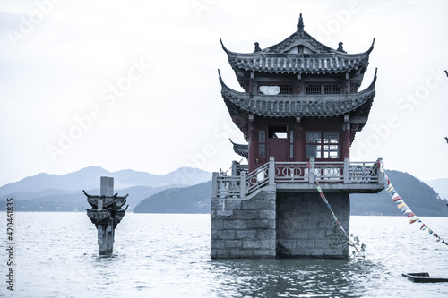 Leinwand Poster The landscape of ancient Chinese architecture archways, pavilions, terraces and towers in the center of Poyang Lake, a submerged spectacle, is located in Jiujiang City, East China's Jiangxi Province
