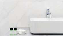 Mini Bottles With Cosmetic Products In Bathroom