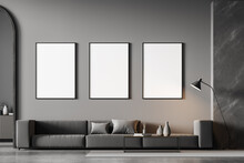 Modern Living Room Interior With Arch And Three White Poster On Dark Wall. Grey Sofa With Cushions, Coffee Table, Chest Of Drawers And Lamp. Concrete Floor.