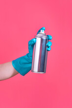 Hand Holding A Spray Can