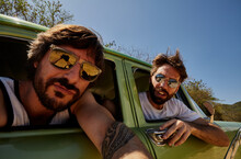 Casual Men Looking At Camera While Taking Selfie In Car Window