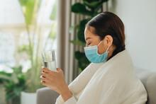 It's Flu Season. Sick Woman Holding Water Glass And Thinking