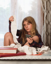 Girl Holding Paper Receipt At Desk