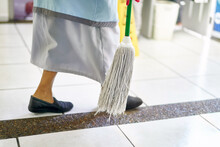 Concept Photo Of A Cleaning Lady In An Official Building