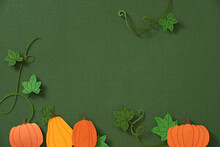 Autumn Leaves And Pumpkins Border Frame With Space Text On Green Background.