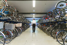 Senior Man Walking In Underground Bicycle Parking Space