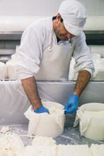 Adult Worker In Cheese Shop