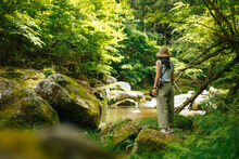 A Woman Visiting The Source Of Yahagi River In Deep Forest In Nagano, Japan