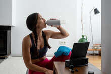 Woman Drinking Water After Practicing Yoga