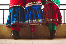 Three Andean Women Wearing Colored Skirts