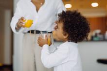 A Boy With A Glass Of Orange Juice