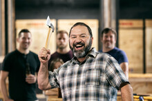 Bearded Man Laughing While Throwing Axe