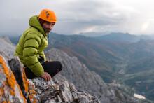 Mountaineer Preparing Gear Before Storm