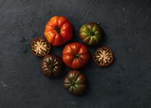 Still Life Of Heirloom Tomatoes On Dark Background