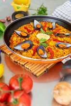Top View Of A Spanish Paella On Pan On Table