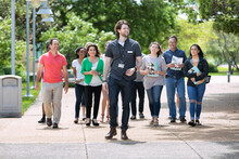 Tour: Guide Leads Group Through College Campus