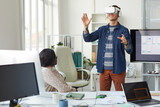 IT Developer Using VR Technology in Office