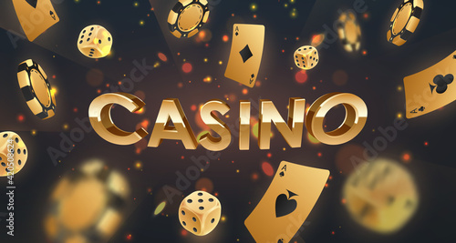 Photo Gold 3d letters Casino with falling golden poker chips, tokens, dices, playing cards on black background with lights, sparkles and bokeh