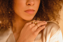Details Of Gold Jewelry On Young Woman