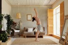 Practicing Sun Salutation Yoga In Morning