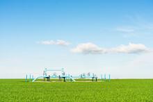 Blue Oil Valves On Green Field