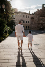 Father And Son Walking In The City