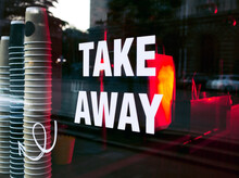Take Away Sign On The Cafe Window