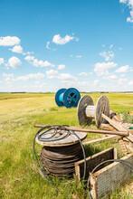 Large Blue Cable Reels On Grassland