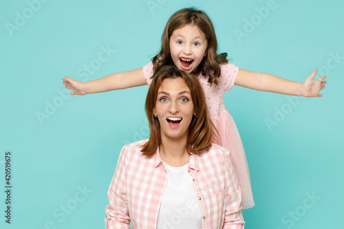 Happy woman in pink clothes have fun with child baby girl 5-6 years old Mommy li Fototapeta