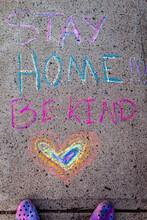 Stay Home Be Kind Written In Sidewalk Chalk On A Sidewalk. . Uplifting Message