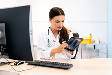 Female Doctor Using Tablet