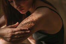 Woman Applying Coffee Scrub