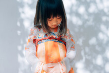 Chinese Little Girl Play In Traditional Garden
