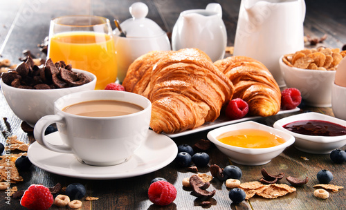 Breakfast served with coffee, juice, croissants and fruits Fototapeta