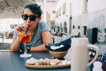 Woman Enjoying An Italian Aperitif With A Sprizz
