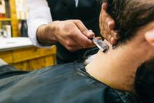 Crop Stylist Shaving Man