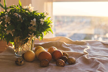 Happy Easter! Modern Pastel Easter Eggs With Spring Flowers On Rustic Linen Cloth In Sunny Light