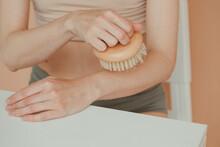Unrecognizable Woman Doing Brush Massage On Arm