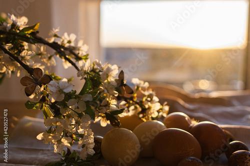 Cuadros en Lienzo Happy Easter! Modern pastel easter eggs with blooming cherry branch on rustic li