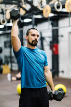 Muscular Man Exercising With Dumbbell Weights