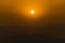 Orange Sunset And Mountains Silhouettes
