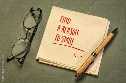 Obraz Find a reason to smile - inspirational handwriting on a napkin with a cup of coffee, positive attitude and mindset concept - fototapety do salonu