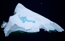 Greenland Melts, Meltwater Pool Forms On Massive Arctic Iceberg, Aerial Drone Birds Eye View