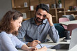 Leinwandbild Motiv Two happy diverse business people professional employees workers having discussion working together having fun at office meeting. Indian teacher and latin student having friendly conversation.